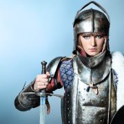8217522 - portrait of a medieval female knight in armour over grey background.